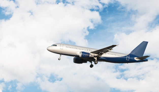 airplane-flying-cloudy-sky_
